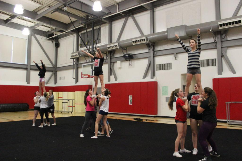 Preforming the routine, the 12 girls practice a stunt.