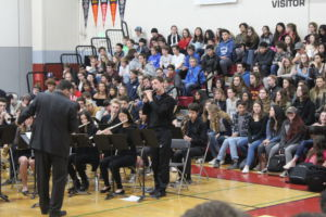 Standing up, senior Jeremy Goldwasser performs a solo on his flute.