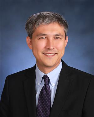 Superintendent David Yoshihara, pictured above, and members of the district negotiating team removed a health care cap from the negotiating table.