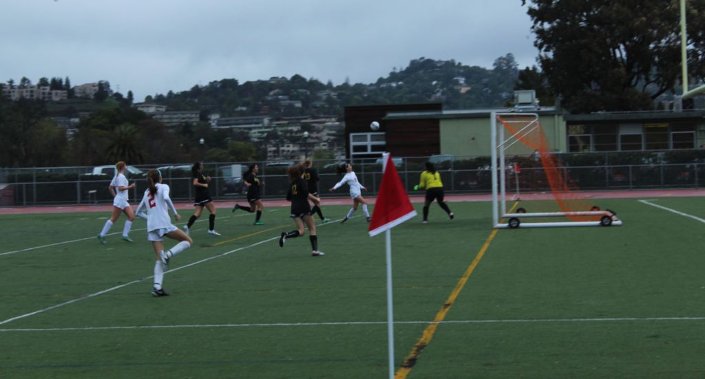 Sprinting down the field, junior Hannah Halford attempts a shot on goal.