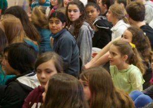Hall Middle School students sit during an assembly with the Peer Resource class
