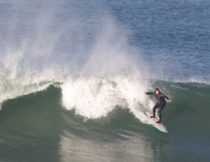 Shredding a wave, Integrated and Environmental Science teacher Mitch Cohen seeks his adrenaline rush.