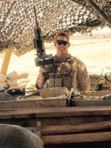 Redwood alum and United States Marine Henry Mesker stands with his weapon while on tour in Iraq.