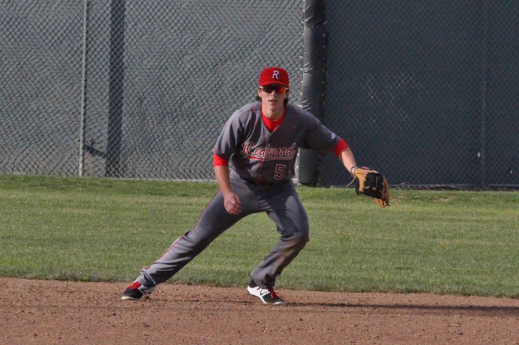 Moving to field a ground ball, Zeisler's career at Redwood has prompted shifts throughout different positions on the diamond