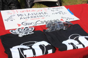 T-shirts, bracelets and keychains were sold at the game to support melanoma research and awareness.