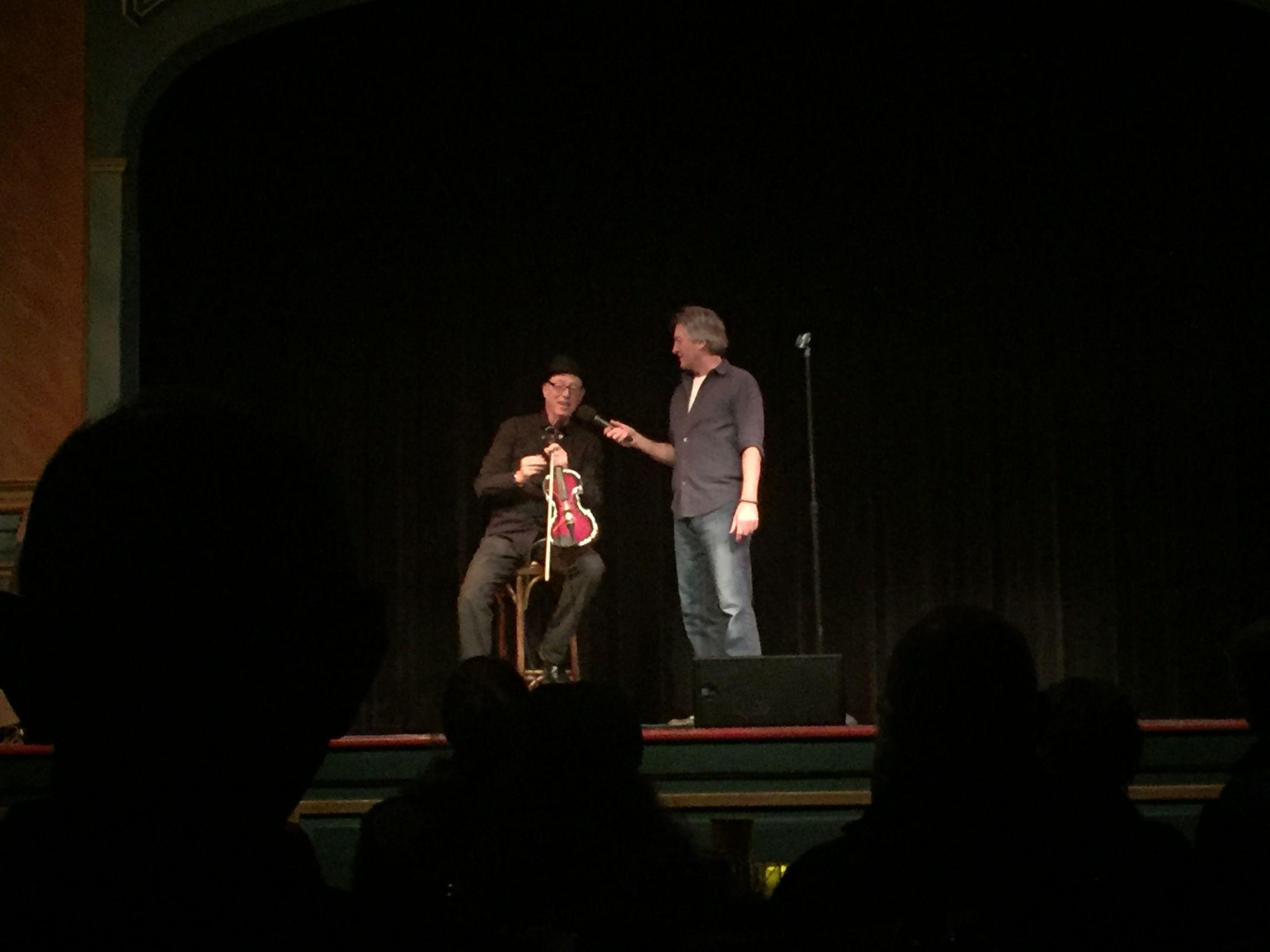 Taking the stage, host Mark Pitta adds humor between each act at Throckmorton Theatre's weekly