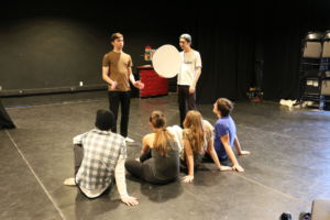 The cast of the Lenaea Festival rehearse the play together.