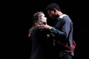 Juniors David Simpson-Heil (playing Macbeth), and Zoe Grandy (playing Lady Macbeth) embrace.