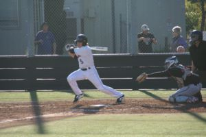 Senior Henry Zeisler finishes his swing after a base hit.