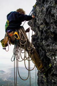 Sophomore Niklas Korn hauls his gear as he climbs.