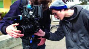 Garet Jatsek adjusts a camera during the production of a Redwood TV episode.