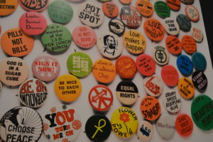 A poster hangs on the wall displaying popular pins that from time that could also be found in the gift shop.