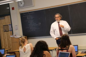 ERNESTO DIAZ LECTURING his AP Research students