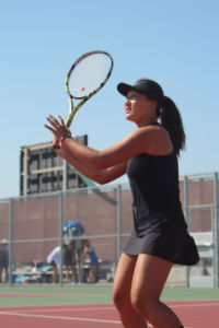 Freshman Chloe Chang prepares to return with a volley against her opponent.