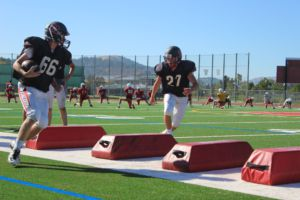 #27 junior Cole Rehm gets ready to tackle #66 senior Drew Kellerman during practice