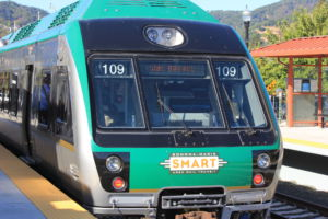 Loading its passengers, the SMART Train sits at the San Rafael Station, the end of the line
