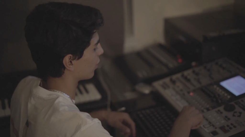 Working on new beats, senior Shayan Davaloo began professionally producing music at the age of 13.