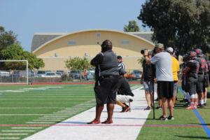 Coach Allen Talley calls plays in Redwood's win vs. Ukiah on September 9th