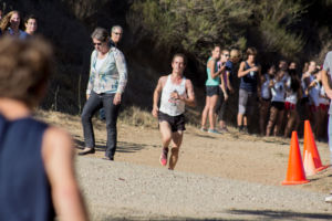 With the finish line in sight, junior Liam Anderson races up the final incline