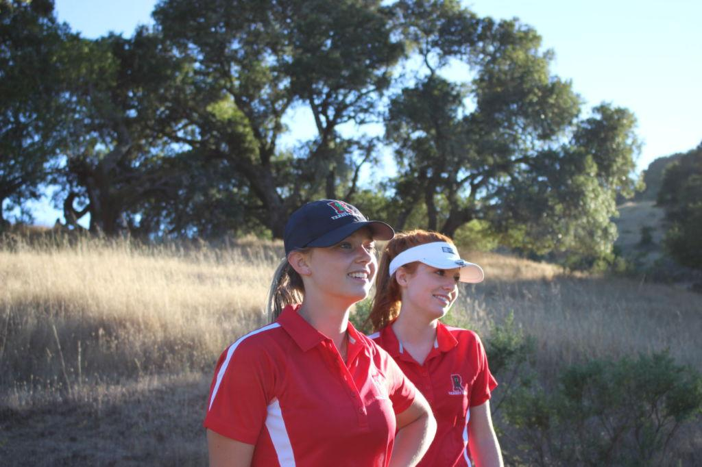 Cambry Weingart and Nina Cinelli watch the ball of a Branson player.