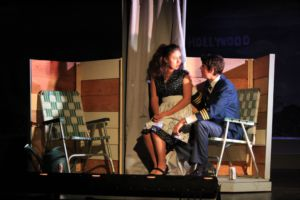 GiGi Buddie, playing Paula Trent, sits on Jake Hanssen playing Jeff Trent