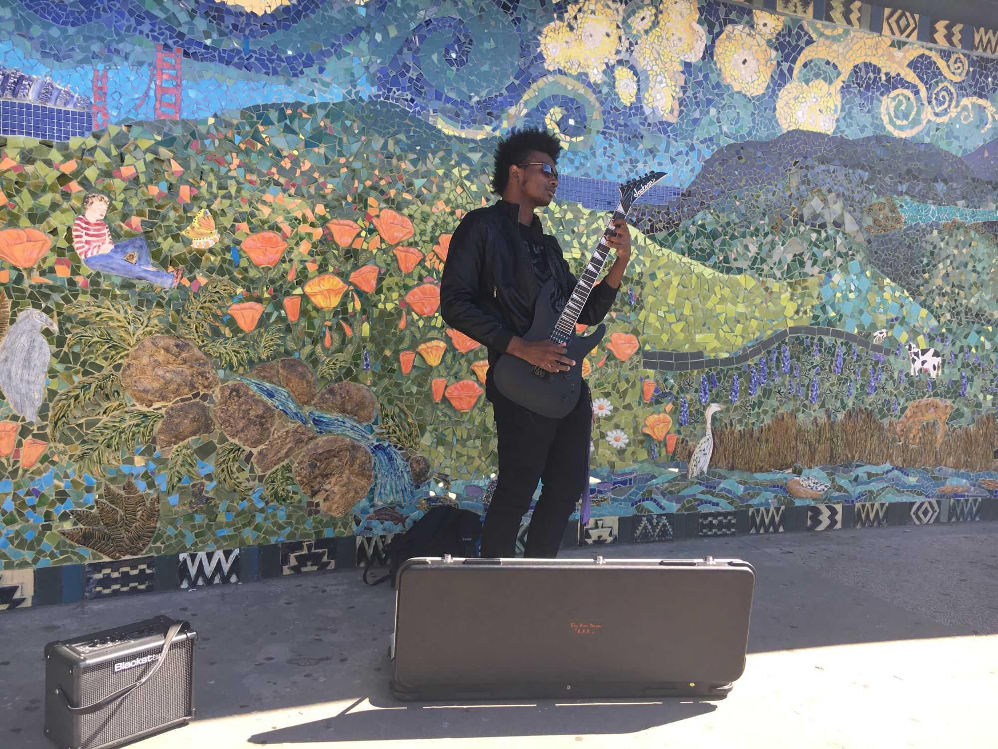 TJ Harris turns Redwood's hallways into his musical playground