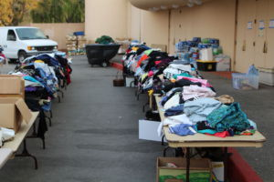 Piles of donated clothing sorted outside of the Marin County Civic Center, an evacuation center for the fire refugees.