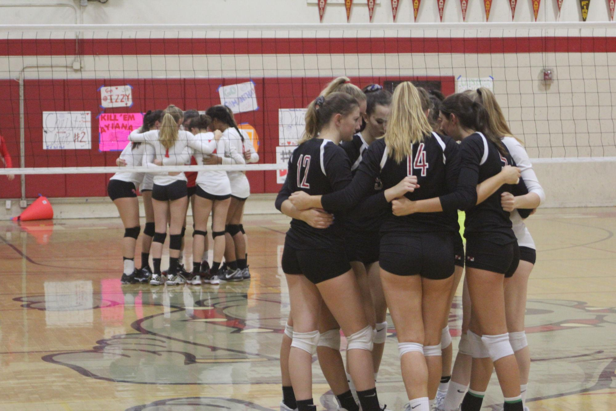 Varsity volleyball's tenacious offensive digs up a win vs. Bulldogs