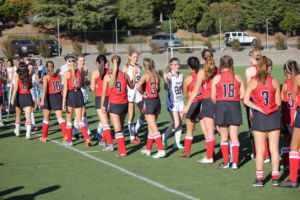 Following a competitive game against Marin Catholic, Redwood lines up to shake the other team's hands.