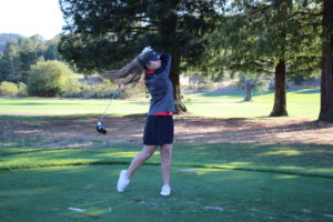 Junior Sophia Lui tees off the ball toward the green.