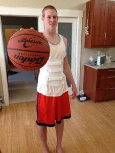 Courtesy of Elliot Dean: Elliot on a typical day, wearing his back brace.