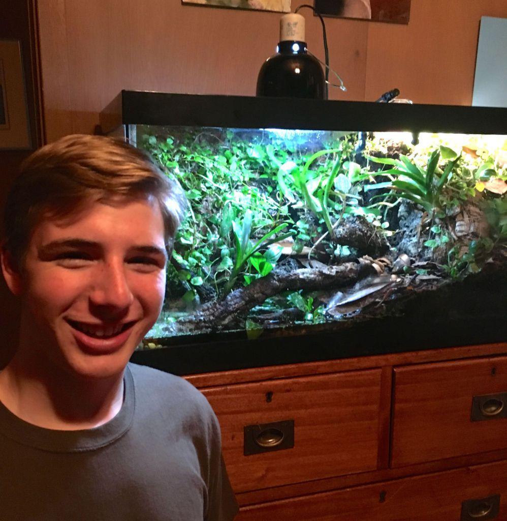 Jordan-McDaniels standing in front of his terrarium