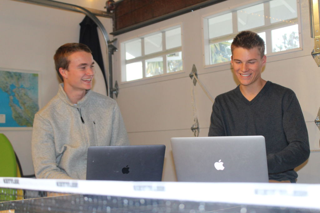Laughing+together+in+their+workspace%2C+Grant+Barnes++%28left%29+and+Zach+Tull+%28right%29+discuss+their+daily+agenda+for+their+business+Peer+Tutor