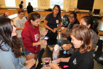 The Bring Change to Mind Club making stress balls during a meeting.