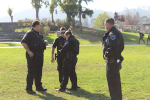 Discussing today's plan, four Central Marin police officers gather on the South Lawn.