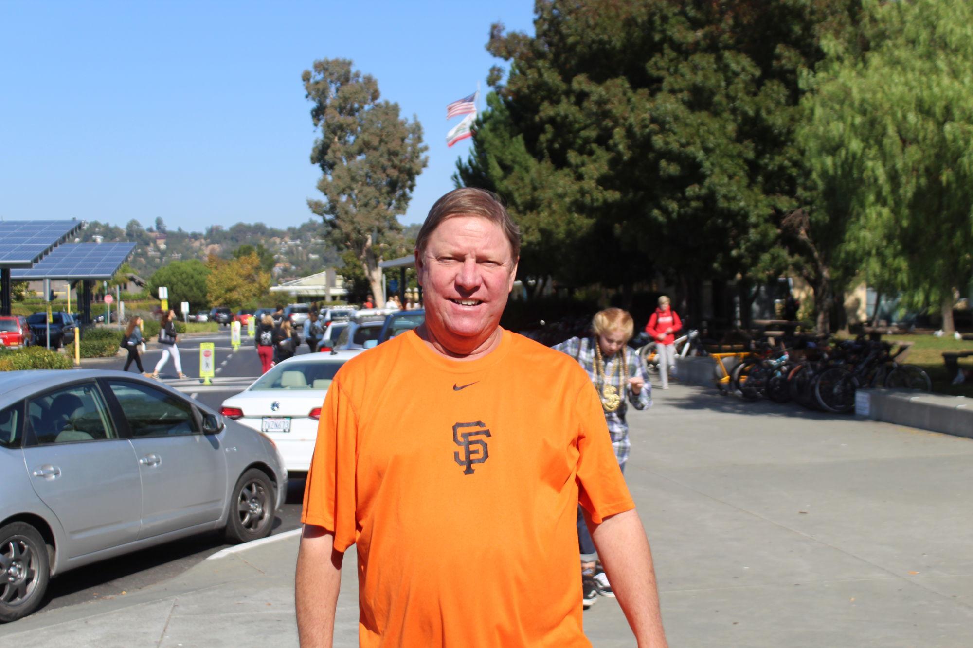 Greeting+his+students%2C+PE+teacher+Mike+Dibley+wears+orange.