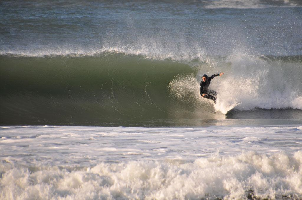 What compels Redwood surfers to chase the swell?