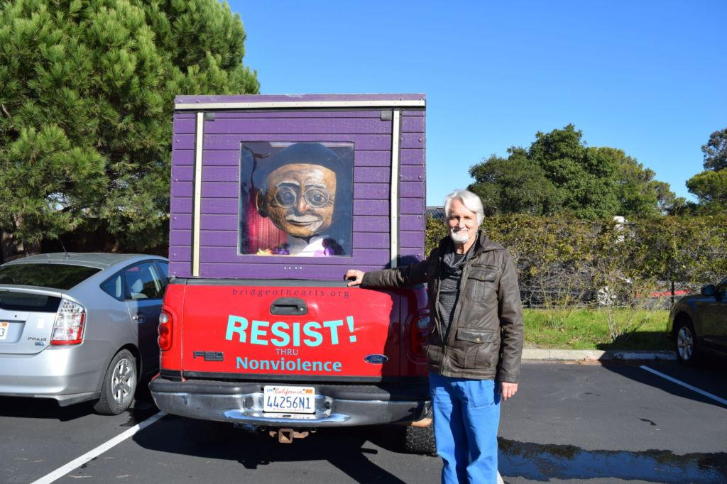 The man behind the Gandhi truck and smiling suns