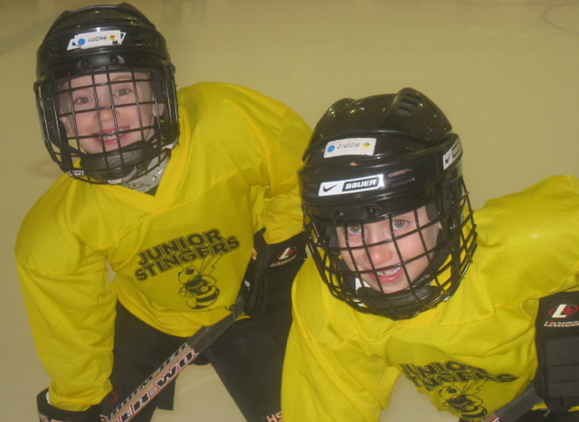 Playing at a rink in Canada, Lucas (left) and Jacob (right) have been involved with hockey since they were very young.