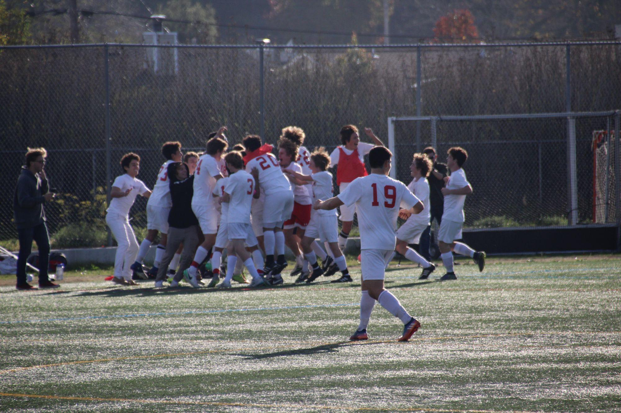 The team celebrating after Rogans goal on a free kick