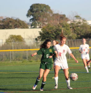 Focusing on the play, sophomore Delaney Anderson competes for the ball.