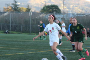 Running down the field, senior Hannah Halford scored the second goal of the game.