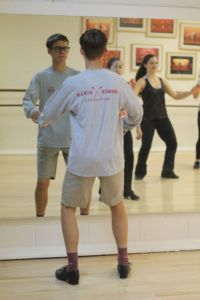 Following the moves of his instructor, John continues to advance his capabilities as a dancer.