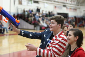 Shooting t shirts into the crowd, junior Greg Datchler spreads the game day spirit.
