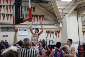 Senior Omar Elliott-Diab dunks over his opponents in the final minutes of the game.