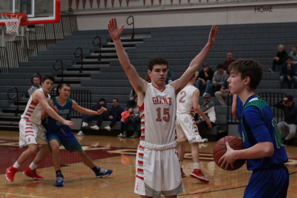 Hands up, senior guard Josh Katz tries to defend the inbound pass