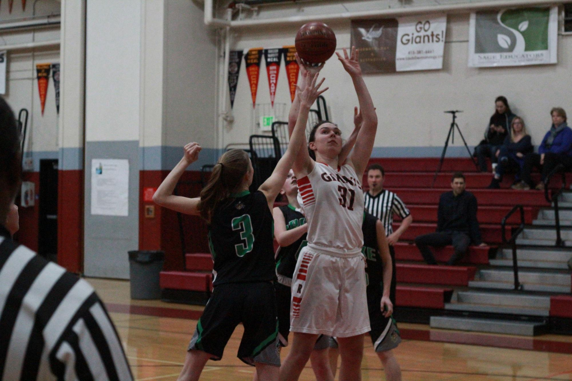 Girls' varsity basketball steals victory from the Pirates