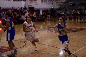 Freshman Kylie Horstmeyer rushes to gain position on defense