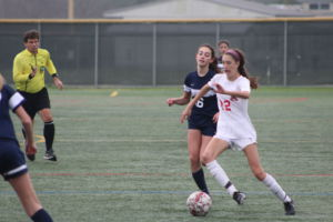 #12 Maddie Pero weaves her way through Marin Catholic's defense
