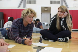 Sophomore Edvard Messler and Senior Desi D'Ancona talk during the 'Two Truths and a Lie' group game.